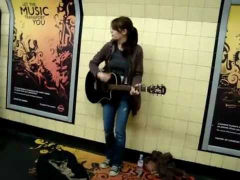 Amazing girl singing & playing in subway station