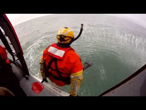 US Coast Guard Rescue Swimmers Jumping from a helicopter
