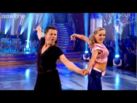 "http://www.bbc.co.uk/strictly Chris Hollins and his dance partner Ola Jordan perform a Showdance to ""Do You Love Me"" by The Contours."