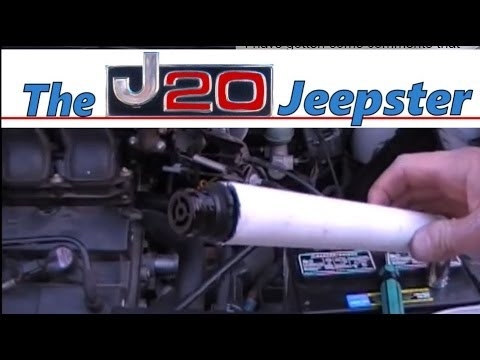 Jeepster replacing PCV valve and hose in a 2000 Ford Taurus.