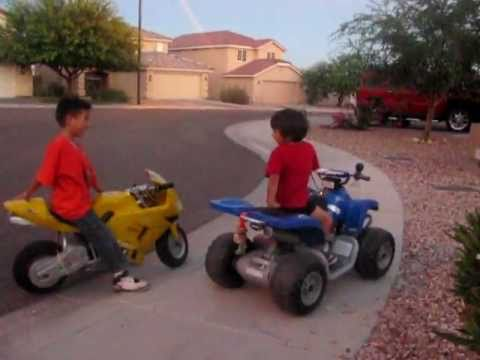 Motorcycle (4 year old on ATV 12 volts versus 7 year old on Motorcycle 36 volts) Music Videos