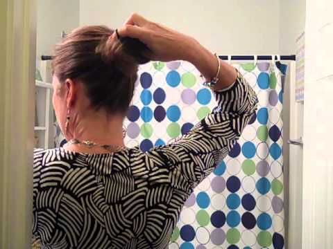 How to put your hair in a pony tail with one hand or arm.MP4