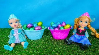 Elsa and Anna toddlers Easter egg hunt with their friends