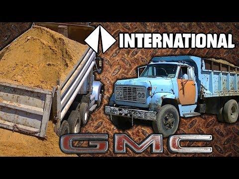 GMC Detroit Diesel and International CAT 3406 Dump Trucks Dumping Sand