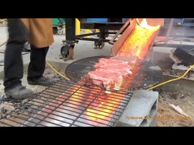 Grilling up a steak over molten lava - no comment