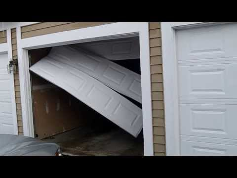 an emergency garage door repair we fixed in wheaton,il * HIT DOOR pt.1