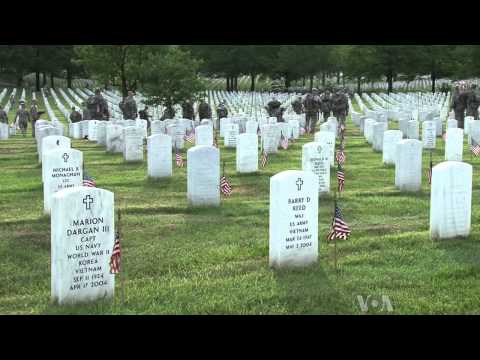 Soldiers Place US Flags in Arlington Cemetery for Memorial Day