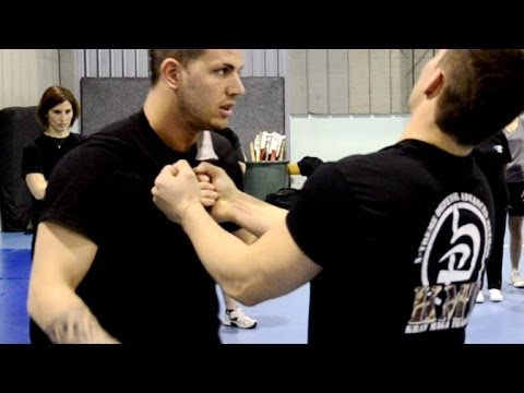 KRAV MAGA TRAINING • How to disarm a Knife to Throat (part 1) Image 1