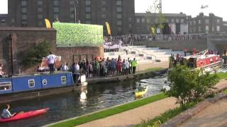 Narrowboat protester at Olympic Torch relay. Granary Square. Thurs 26th July 2012