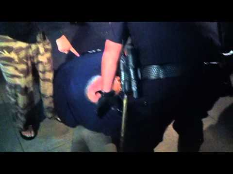 Woman illegally detained by fascist pig and racist media at Anaheim Protest.