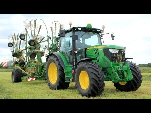 Raking grass with a New John Deere 6125R + Krone Swadro 1400 Plus!