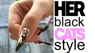 HER BLACK CAT NAIL STYLE IS SHOCKING FOR SOME PEOPLE BUT SHE KEEPS ON DOING HER CAT CLAW NAILS