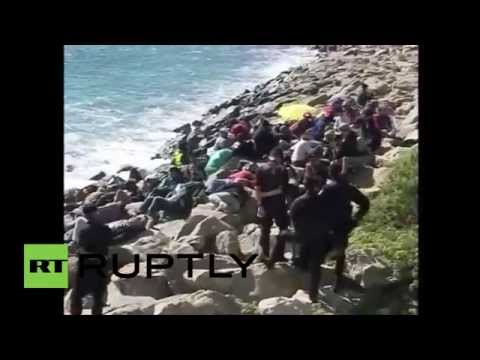 Italy: Police clear migrant camp on border with France