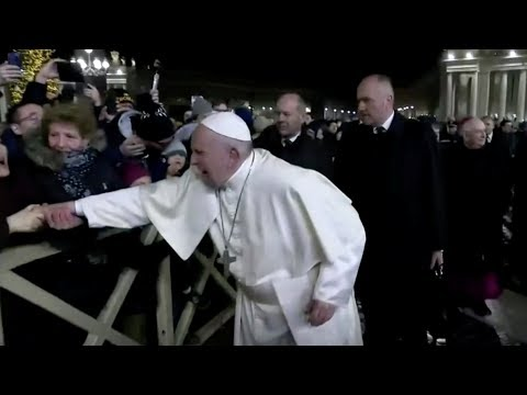 Pope slaps woman's hand to free himself from her grip