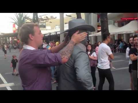 Street performer punches annoying guy