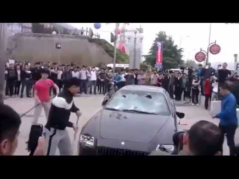 Unhappy owner of Maserati destroys his car in protest | Angry Chinese Car Owner Destroy Maserati