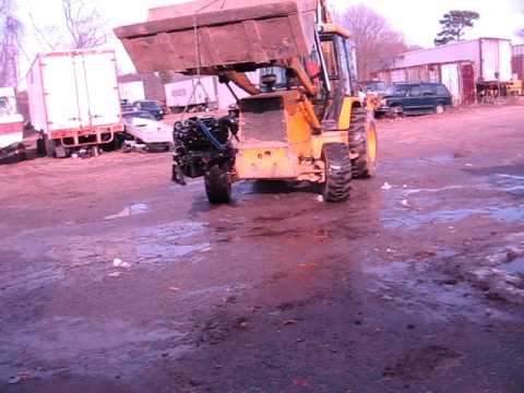 Removing the Mercruiser motor from Rinker boat with John Deere 310 backhoe.