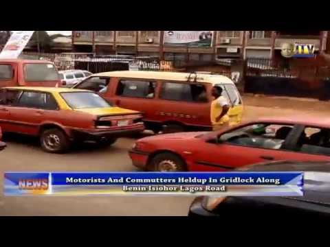 Motorists And Commuters Held Up In Gridlock Along Benin Isiohor Lagos Road