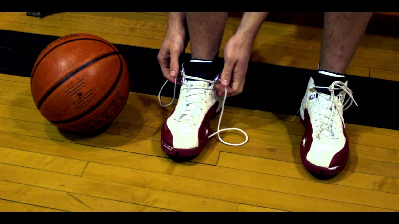 royalty free stock footage of tying basketball
