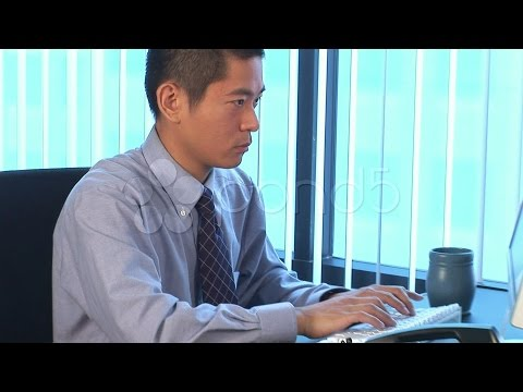 Young Asian Businessman Typing On Computer. Stock Footage