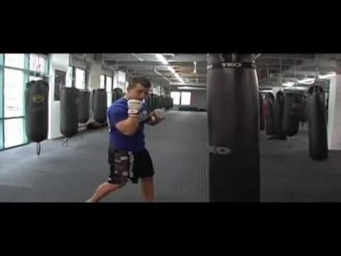 CKO Kickboxing Heavy Bag Combinations Jab Cross Hook Uppercut Image 1