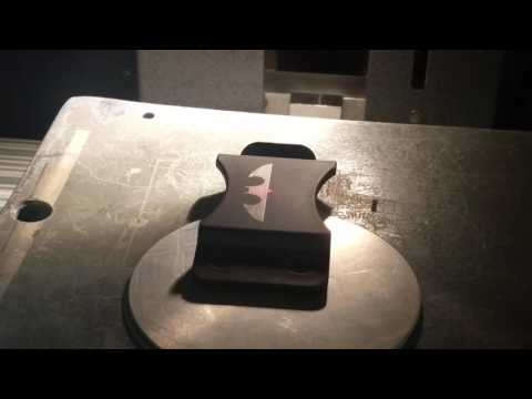 High speed laser raking of concealed weapon plastic clips.