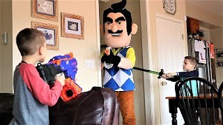 Nerf War : Hello Neighbor vs PBT Squad (Spell Book Found 2019)