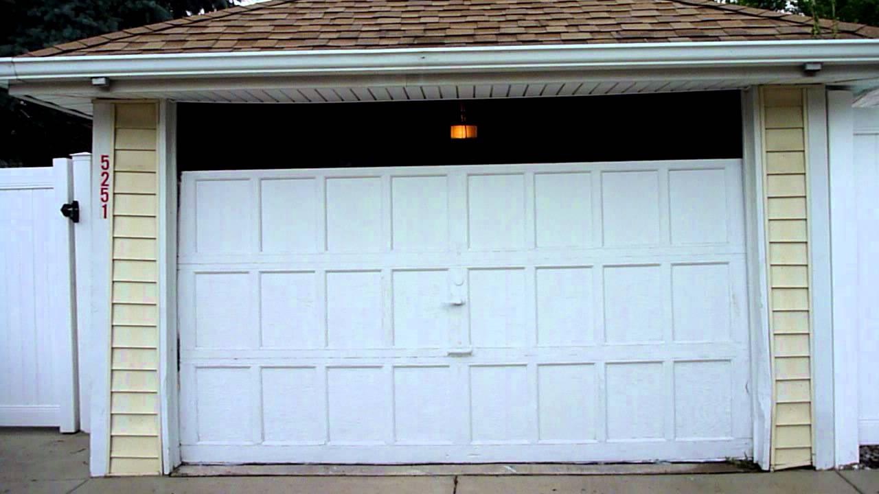 Garage door installation part 1 youtube for 10 x 7 garage door menards