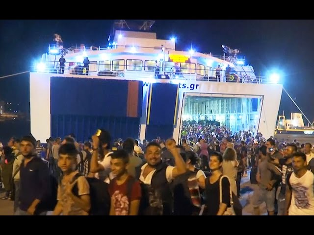 Ferry carrying thousands of migrants arrives from Lesbos