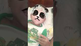 Funny baby playing with Snapchat filters