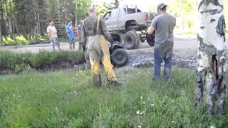 Souped up canam 800 goes through big mud hole 4x4 trucks only go through