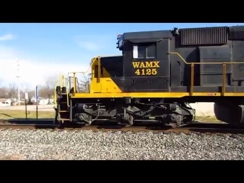 Grand Elk freight with Conrail, N&W, SOUTHERN  covered hoppers