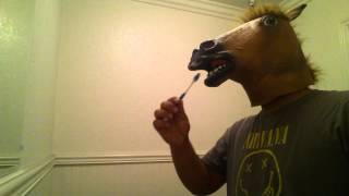 Wonder how a horse brushes his teeth?