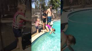 rewind father son jumping in pool