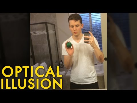 Magically throwing a ball through a mirror