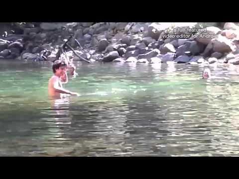 Mando dips in the Merced river in Yosemite