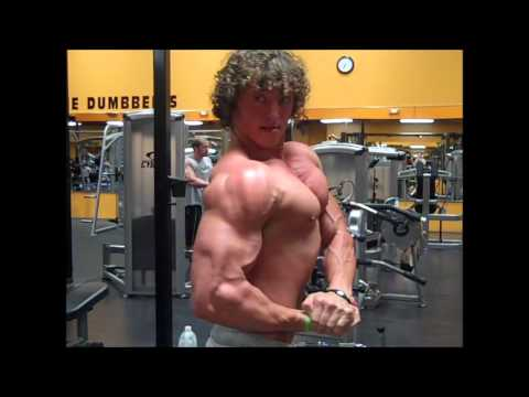 Ripped BodyBuilders Flexing in the GYM