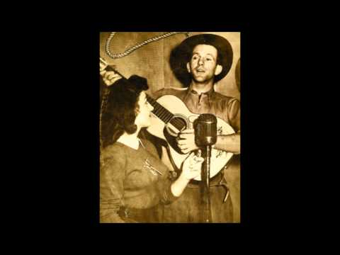 Tex Morton - He Holds The Lantern While His Mother Chops The Wood video