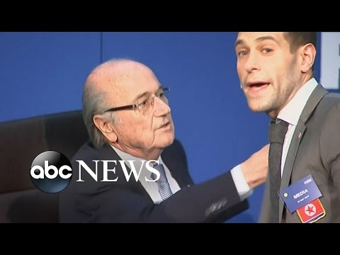 Security Reacts Quickly as FIFA's Sepp Blatter Approached by Demonstrator