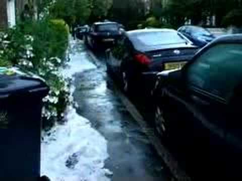 freak weather. lillieshall road clapham old town london UK 3rd july 2007.