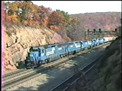 We are between Altoona and Horse Shoe curve on the Pennsy mainline in the Allegheny's on a beautiful fall day. A west bound with three ex-Erie Lackawanna SD4...