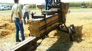 Bailing straw with a McCormick Deering Hay press