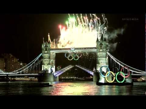 Olympic Torch passes Tower Bridge (with David Beckham on board)