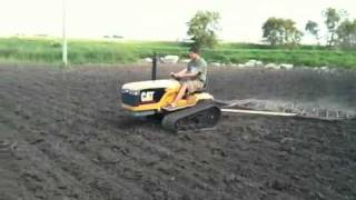 Mini CAT Challenger pulling 4 harrows