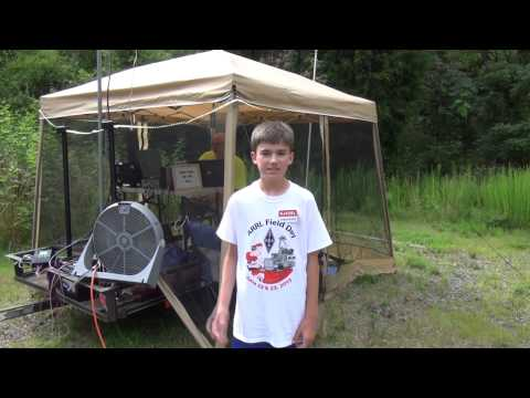 13 year old Christopher Tate, Public Information Officer for the Alamance Amateur Radio Club (K4EG), gives us a tour of their station for ARRL Field Day 2013...