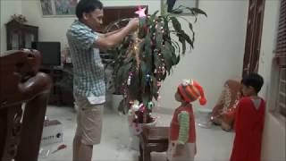 Chơi cùng con. bé Tùng Chi cùng với bố đi mua đồ về trang trí cây noel