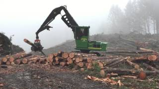 John Deere 2954D with SouthStar FD750 grapple processor