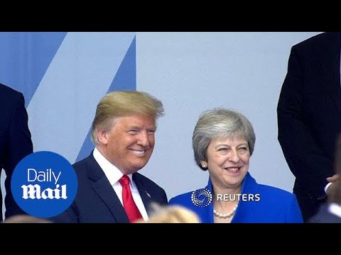 Donald Trump and Theresa May pose for photos at NATO summit - Daily Mail