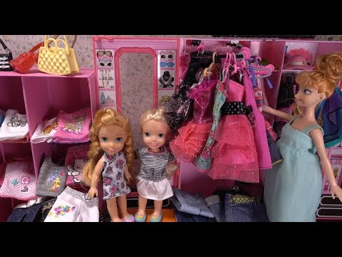 Elsa and Anna toddlers at Barbie's boutique- new dresses, accessories and customized clothes