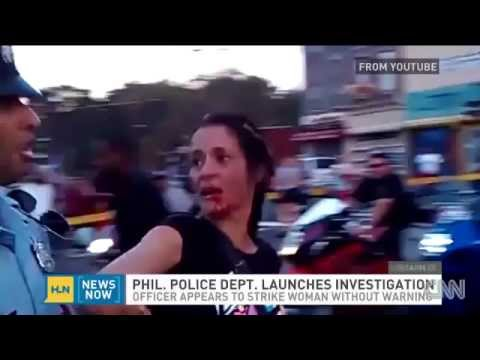 POLICE BRUTALITY - Philadelphia Cop Sucker Punches Woman In The Face During Parade